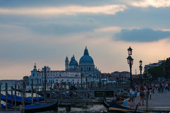 Gondola station with tourists at dusk. Venice stock images