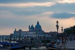 Gondola station with tourists at dusk. Venice Stock Images
