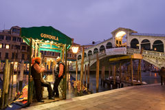 Gondola stop by Rialto bridge royalty free stock photography