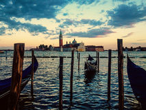Gondola on sunset. Gondola, sunset and church of san giorgio maggiore Stock Photo