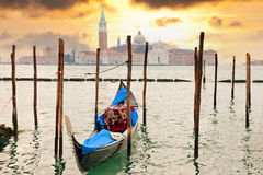 Gondola at sunset pier near in Venice, Italy Royalty Free Stock Photography