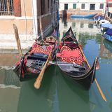 Gondola - symbol of Venice, narrow side channel, Venice, Italy. Gondola is iconic traditional boat, very popular means of transport for tourists Royalty Free Stock Photo