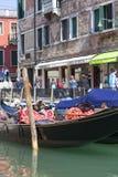 Gondola - symbol of Venice, narrow side channel, Venice, Italy. VENICE, ITALY-SEPTEMBER 22, 2017: Gondola - symbol of Venice, narrow side channel. Gondola is Stock Image