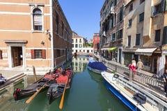 Gondola - symbol of Venice, narrow side channel, Venice, Italy. VENICE - ITALY, SEPTEMBER 22, 2017: Gondola - symbol of Venice, narrow side channel. Gondola is Royalty Free Stock Photography