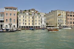 Gondola and taxi by the Grand Canal Royalty Free Stock Photos