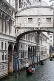 A gondola tour. In Venice under the bridge of sighs royalty free stock photos