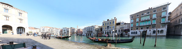 Gondola Tour in Venice Italy. VENICE - February 20: Gondola with tourists on February 20 2016 in Venice, Italy. The gondola is a traditional Venetian rowing boat Royalty Free Stock Photography