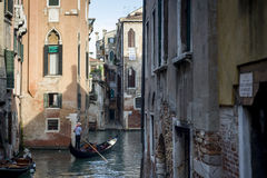 Gondola with tourist in Venice Stock Images