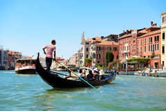 The gondola with tourists is on Grand Canal Stock Images