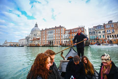 Gondola with tourists in Venice Stock Images