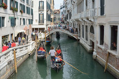 Gondola with Tourists in Venice - Italy. Stock Photography