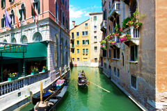The gondola with tourists is on water channel Royalty Free Stock Photo