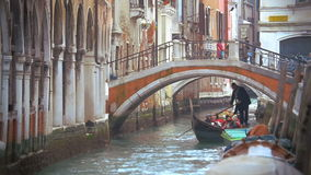 Gondola traveling and sightseeing of Venice stock footage