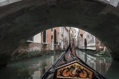 Gondola Under a Bridge in Venice. From a Trip with a Gondola around Venice, Italy Royalty Free Stock Photo
