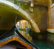 Gondola under arch of bridge Stock Photos