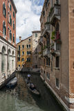 Gondola Under The Terraces of Venice. From a Trip around Venice, Italy royalty free stock images