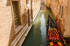 Gondola in a Venetian canal, the old district of Venice without Stock Images