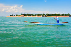 Gondola in Venetian Lagoon in summer day Stock Photography