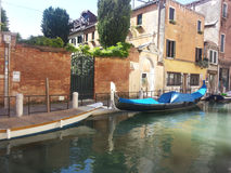 Gondola a Venezia. Gondola blue on the green water of a canal of Venice Royalty Free Stock Images