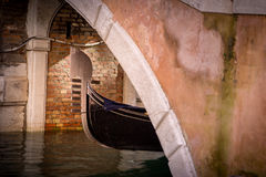 Gondola in Venezia. A gondola under a bridge in Venezia Stock Photo