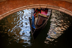 Gondola in Venezia. A gondola under a bridge in Venezia Royalty Free Stock Photos