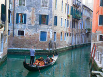 Gondola in venice. Gondola with gondolier and people in venice italy Royalty Free Stock Image