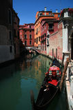 Gondola in Venice. Parked gondola in one of the canals in Venice, Italy Stock Photos