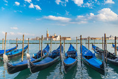 Gondola in Venice. The beautiful view of traditional Gondola boat on canal with historic Basilica di Santa Maria della Salute in the background on a sunny day Royalty Free Stock Photography