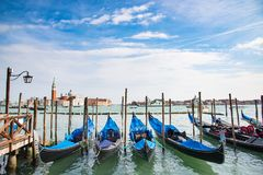Gondola in Venice. The beautiful view of traditional Gondola boat on canal with historic Basilica di Santa Maria della Salute in the background on a sunny day Stock Photography
