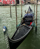 Gondola in Venice. Black Gondola sitting empty on the grand Canal Royalty Free Stock Image