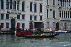 Gondola in Venice canal, Italy. VENICE, ITALY - MARCH 28: Tourists on a Gondola, March 28, 2012 in Venice, Italy. The city has an average of 50,000 tourists a Stock Image