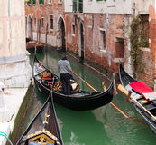 Gondola in Venice channel. With gondoliero Royalty Free Stock Photography