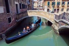 Gondola in Venice. VENICE, ITALY - MAY 27, 2015: Tourists on a gondola on sunny day in Venice, Italy stock photos
