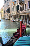 A gondola in venice near buildings Stock Photos