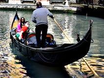 Gondola in Venice. People are happy in gondolas Stock Image