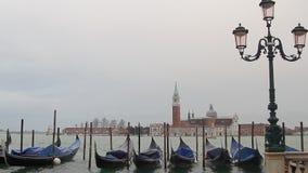 Gondola in Venice and San Giorgio Maggiore stock footage