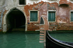 Gondola waiting. Gondola floating in a calm canal in Venice stock image