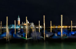 Gondolas anchored on Grand Canal in Venice Stock Photo