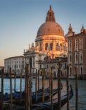Gondolas and Basilica di Santa Maria della Salute in Venice Stock Photo