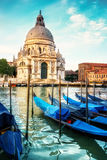 Gondolas and Basilica Santa Maria della Salute in Venice Stock Photography