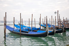 Gondolas with blue cover in Venice Stock Photography