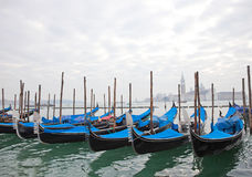 Gondolas with blue cover in Venice Royalty Free Stock Image