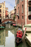 Gondolas and Boats on Canal  Venice, Italy Stock Image