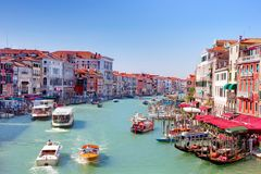 Gondolas and boats on the Grand Canal in Venice Royalty Free Stock Photo