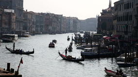 Gondolas and boats passing by the Grand Canal view from Rialto bridge, Venice stock video