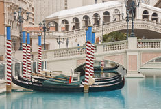 Gondolas in Canal by Bridge Royalty Free Stock Image