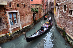 Gondolas on canal in Venice Stock Images