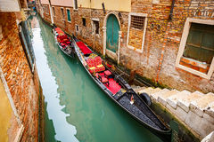 Gondolas on canal in Venice Stock Photos