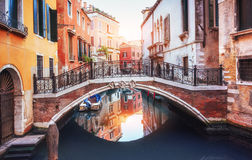 Gondolas on canal in Venice.  is a popular tourist destination of Europe Stock Photo