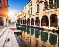 Gondolas on canal in Venice. Venice is a popular tourist destination Stock Photo
